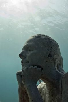 THE GARDENER:Depth 5m, MUSA Collection, Punta Nizuc, Mexico. Underwater Sculpture by Jason deCaires Taylor      Taylor founded and created the world's first underwater sculpture park. Situated  of the west coast of Grenada in the West Indies. Following on in 2009 he co-founded MUSA (Museo Subacuático de Arte), a monumental museum with a collection of over 500 of his sculptural works, submerged off the coast of Cancun, Mexico.