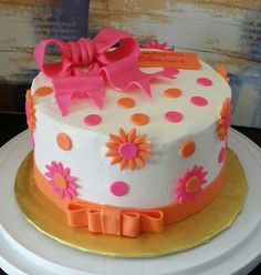 """Baby shower cake for girl. 8"""" round covered in butter cream and fondant embellishments."""