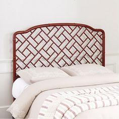 Designed in the classic Chinese Chippendale style, our Dayna Headboard layers in romantic global charm. The frame's airy fretwork is hand carved of solid hardwood with subtle bamboo turnings for a touch of exotic texture. Dayna Headboard features: White finish is lightly rubbedHand craftedFully assembledAttaches to bed frame (sold separately) with included hardware