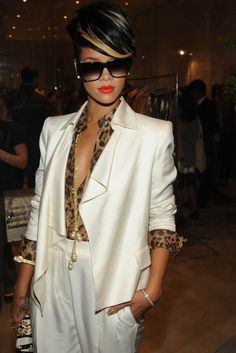 a3fbe3fb45883 Rihanna at the Derek Lam SoHo Store opening party. Animal print   white  look chic together!