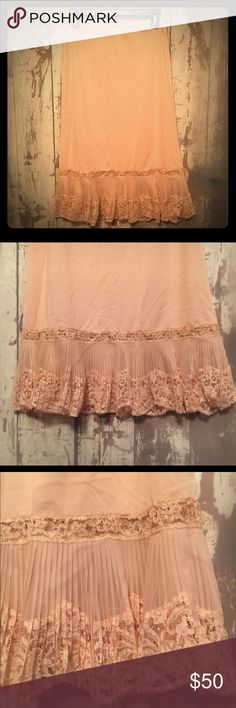 Vintage Vanity Fair Half Slip Gorgeous vintage Vanity Fair Half Slip with pleated Hem and Lace Swag. Satin tab in the waistband of Slip. In wonderful condition with no signs of Wear or tear. Tricot nylon Size Small. vintage vanity fair Intimates & Sleepwear Chemises & Slips