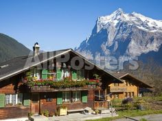 Traditional Houses, Wetterhorn and Grindelwald, Berner Oberland, Switzerland by Peter Hurd Landscapes Photographic Print - 61 x 46 cm