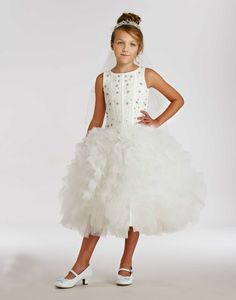 Macis Couture-Designer Girls Dress Style T1865W- Embroidered Tulle Dress with Ruffle Skirt  This dress is made from Macis Design Company and they are committed to designing dresses of couture quality, unique designs and LOTS of details. Take a look at this beautiful gown that came straight off the runway of bridal couture.  http://www.flowergirldressforless.com/mm5/merchant.mvc?Screen=PROD&Product_Code=MD_T1865W&Store_Code=Flower-Girl&Category_Code=Lilac