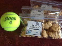 "Animal cookies in snack bags with saying on card in bag.  ""Be an animal on the court!""  Pumping up the tennis team before the match."