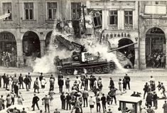 Soviet tank rams into a building - Warsaw Pact invasion in Czechoslovakia, 1968