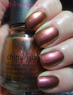 china glaze Cabin Fever is a duochrome that shifts from a rusty copper to rose and greenish gold.