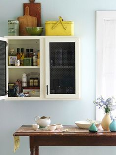 Get standout kitchen cabinets with metal inserts crafted from radiator screens./
