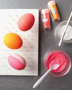 "Glittered Eggs: Craft glue and glitter.  Use pin/nail rack.  Or if using cardboard eggs, can use 12"" bamboo wooden skewers (faster if doing several at a time).  Color eggs underneath the same color as the glitter for better result."