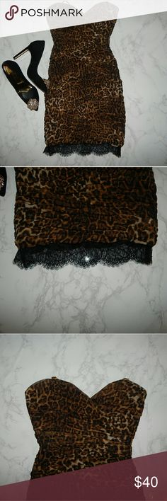 BCBGMaxAzria Leopard Strapless Dress w/ Lace Excellent Condition.  Leopard Dress with lace detail on the bottom. Sweetheart strapless dress BCBGMaxAzria Dresses