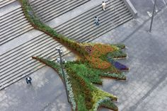 The garden climbs the stairs, running in undulating lines of different textures and colors. Envisioned as a dynamic urban space; it moves in time and with th...