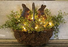 """""""Primitive Basket...with lights and beeswax bunnies.""""  ( Truly lovely. What's more I would like to change it with either the Seasons or with each Holiday we celebrate. The Bunnies make me think of Easter and Spring. Where I live, we had a lovely Easter Sunday. Just waiting for the rest of the snow to get gone so we can get going with Spring Planting!) *smile*"""