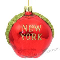 Glass Big Apple New York Christmas Ornaments Glass red apple shape with green glittered leaves. (http://www.nycwebstore.com/glass-big-apple-new-york-ornament/)