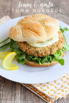 Lemon and garlic tuna burgers - so quick, healthy, and delicious! www.thebakerupstairs.com