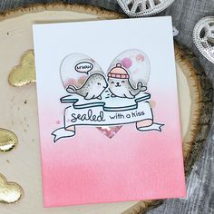 the Lawn Fawn blog: Love themed card by Sharna (using Sealed with a Kiss, Stitched Heart Stackables, Critters in the Arctic)
