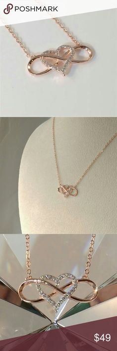 "Infinity Heart Pendant Neckace This exquisite simulated diamond (CZ) pendant necklace in 14k rose gold over sterling silver is 16"" long, adjustable to 18"". There are 29 round cut simulated diamond (CZ) accents. The infinity symbol is 7/8"" wide and the heart is 1/2"" tall. The infinity symbol represents the timeliness of love. Rose gold is trending now! New. Measurements and weights are approximate. Photos may be enlarged to show detail. Jewelry Necklaces"