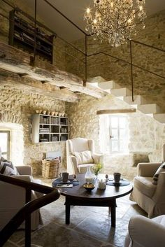 Gorgeous French stone tiny home with chandelier. Look at that light pouring in....