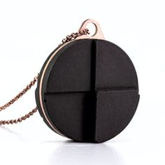 PENDANT 1060 from our Solid Collection | black concrete + laser cut copper plate
