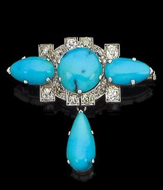 An art deco turquoise and diamond brooch, circa 1920 Set to the centre with a circular cabochon turquoise, within a geometric surround of old brilliant-cut diamonds, with pear-shaped cabochon turquoise arms and swing drop, diamonds approx. 1.10ct. total, French assay marks, width 4.1cm., fitted case