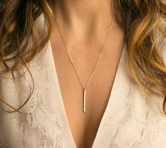 Delicate, Simple Vertical Bar Necklace. The Dainty Vertical Bar is a simple pendant that makes an easy everyday necklace. Looks great alone or layered!  Necklace: MINIMAL VERTICAL BAR (LN120_30_V)  - Top quality USA or Italian made chain and components - All components are 14K Gold Filled, Sterling Silver or Rose Gold Fill - Dainty Vertical Bar is 26mm long - Comes in a cute little package ready for gifting   …………………………………. LAYERED LOOK:  • • Photo #3: Shows these 2 pieces layered together…