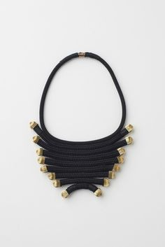 "Pichulick, ""The Fan"" LAYERED BLACK ANDD GOLD NECKPIECE WITH MAGNETIC CLASP, Yacht Braid, Gold Gilted Brass Caps, Wax Cord. Handmade in Cape Town, South Africa. 115.47 USD."