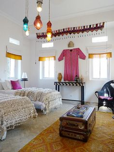 Morocco room from Decor8. Moroccan wedding blanket, dhurri rug and wallpapered ceiling. UGH love.