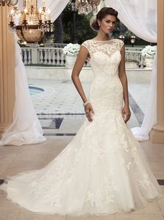 Unique Bateau Fit N Flare Lace Natural Waist Short Sleeve Wedding Dress