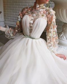 Details - Havana cream color - Organza fabric - Handmade embroidered field flowers with a green ribbon on waist - Ball-gown and an open leg with a heart shaped corset and long-sleeves - For special occasions Elegant Prom Dresses, Grad Dresses, Pretty Dresses, Beautiful Dresses, Evening Dresses, Formal Dresses, Wedding Dresses, Hijab Prom Dress, Floral Prom Dresses