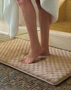 Step out of the shower and onto the soft Indulgence Memory Foam Bath Rug that is as stylish and soft as it is absorbent.