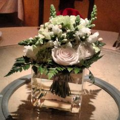 Centerpiece for a 50th Wedding Anniversary Roses + Snapdragon + Green Carnations + Leather leaf - mfrias.eventos@gmail.com