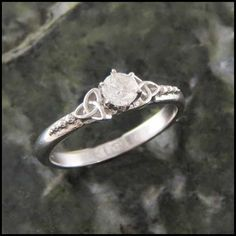 A stunning new Celtic Irish Trinity Knot engagement ring in 14K White Gold with a Cathedral profile.