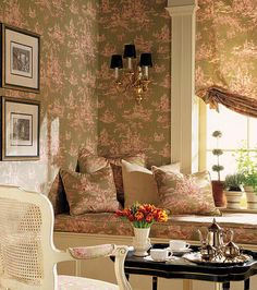Anna French, toile wallpaper and fabric with a touch of black on the sconce shades and coffee table.. Love!