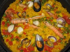 Arroz com Marisco is a signature Portuguese seafood and rice dish combining mussels, prawns, and clams.