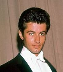 George Chakiris...You'll remember him in West Side Story