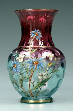 """*HARRACH GLASS WORKS ~ Amberina Vase,  thumbprint surface, rich red to pale blue at base, enameled polychrome flowers, gilt highlights + rims, base w/circular feather plume mark for Harrach Glass Works, Bohemia, late 19th century, 8 1/2""""."""