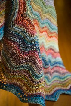 Love the colors, the pattern is the Feather and Fan Comfort Shawl  by Sarah Bradberry FREE pattern to KNIT. Nice share xox.  Now, if only I could do this!