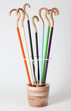 """Omhu, a modern take on a traditional cane, turns the practical tool into an eye-catching accessory. The first product from the NYC-based company's """"Aids For Daily Living"""" collection, the Omhu cane is inspired by the efficiency of Scandinavian furniture & the glossy aesthetic of high-end bicycles. via cool hunting Walking Sticks And Canes, Walking Canes, Fashionable Canes, Paint Dipping, Toothbrush Holder, Disability, Sally, Random Things, Jewel"""
