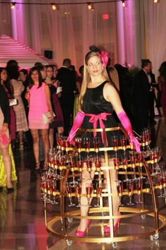 """She's on the move!  """"Champagne Lady"""" brings the bubbly to everyone, without spilling a drop!"""