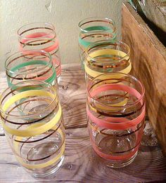 SALE. set of 6 vintage glasses. 4.5 inches tall. painted pastel stripes with gold. gorgeous shades of pink, green and yellow.