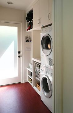 Laundry Room Ideas- Glass door brightens it up, built in cabinets look neat