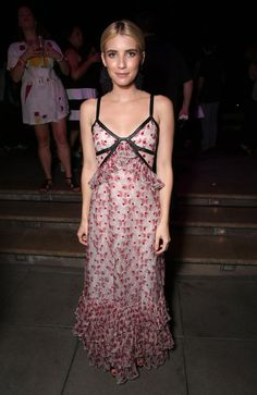 Wearing a ruffled maxi dress with leather piping and Sachin & Babi Noir earrings. Image Source: Getty / Tod...