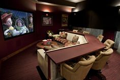 Bar behind couch. Perfect for eating so you wont get crumbs in the cushions but … Bar behind couch. Perfect for eating so you wont get crumbs in the cushions but you can still be in the action. Home Theater Rooms, Home Theater Design, Cinema Room, Movie Theater Basement, Theater Room Decor, Attic Design, Home Theater Seating, Bar Behind Couch, Media Room Design