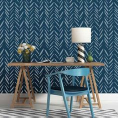 Brush Strokes Allover from Cutting Edge Stencils is a modern wall pattern that combines the Herringbone and Chevron designs with an artistic twist. Stenciled here on an accent wall in blue.