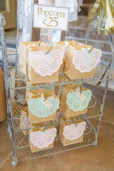 Doily paper bag favors at a carousel birthday party! See more party planning ide. Carousel Birthday Parties, Carousel Party, Tea Party Birthday, Girl First Birthday, Unicorn Birthday Parties, First Birthday Parties, Birthday Ideas, Frozen Birthday, Horse Party