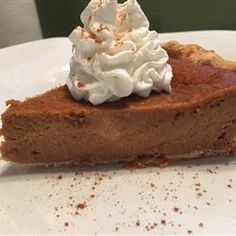 "Mrs. Sigg's Fresh Pumpkin Pie | ""I baked this pie for Thanksgiving this year and it came out great! I was so proud of myself since it was the first time I baked a pie from scratch! Thank you and I will definitely be using this recipe again!"""