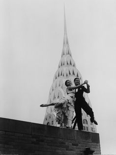 Dancing by the Chrysler Building - Quite a festive touch is lent to the majestic skyline of New York City, by Ramon and Rosita, internationally known dance artists, as they demonstrate the Southampton Hop, new Terpsichorean number, atop of the Chanin Building. The awe-inspiring and modernistic spire of the Chrysler Building looms in the background. Stock Photo ID: U237881P-A Date Photographed: July 18, 1930 Location: Manhattan, New York City, New York State, USA Credit: © Bettmann/CORBIS