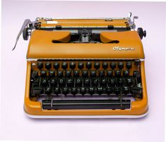 Orange Typewriter by RetroandRevamped on Etsy