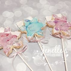 Watercolour & sparkle snowflake cookie pops by Jenelle's Custom Cakes!