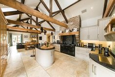 Master Chef: This kitchen is fitted with a comprehensive range of hand-painted, bespoke units from Alexander Carrick with granite work surfaces, 1½ bowl under-mounted sink, four oven oil-fired AGA with gas hob, separate induction hob and oven, integrated dishwasher, fridge, separate fridge/freezer and wine cooler... Aug '16