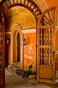 Hacienda - wooden spindle door with yellow / orange walls
