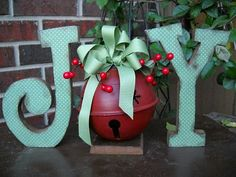 """Cute!!! Buy pre-made letters from craft store and use appro. sized embelished jungle bell as """"O""""."""